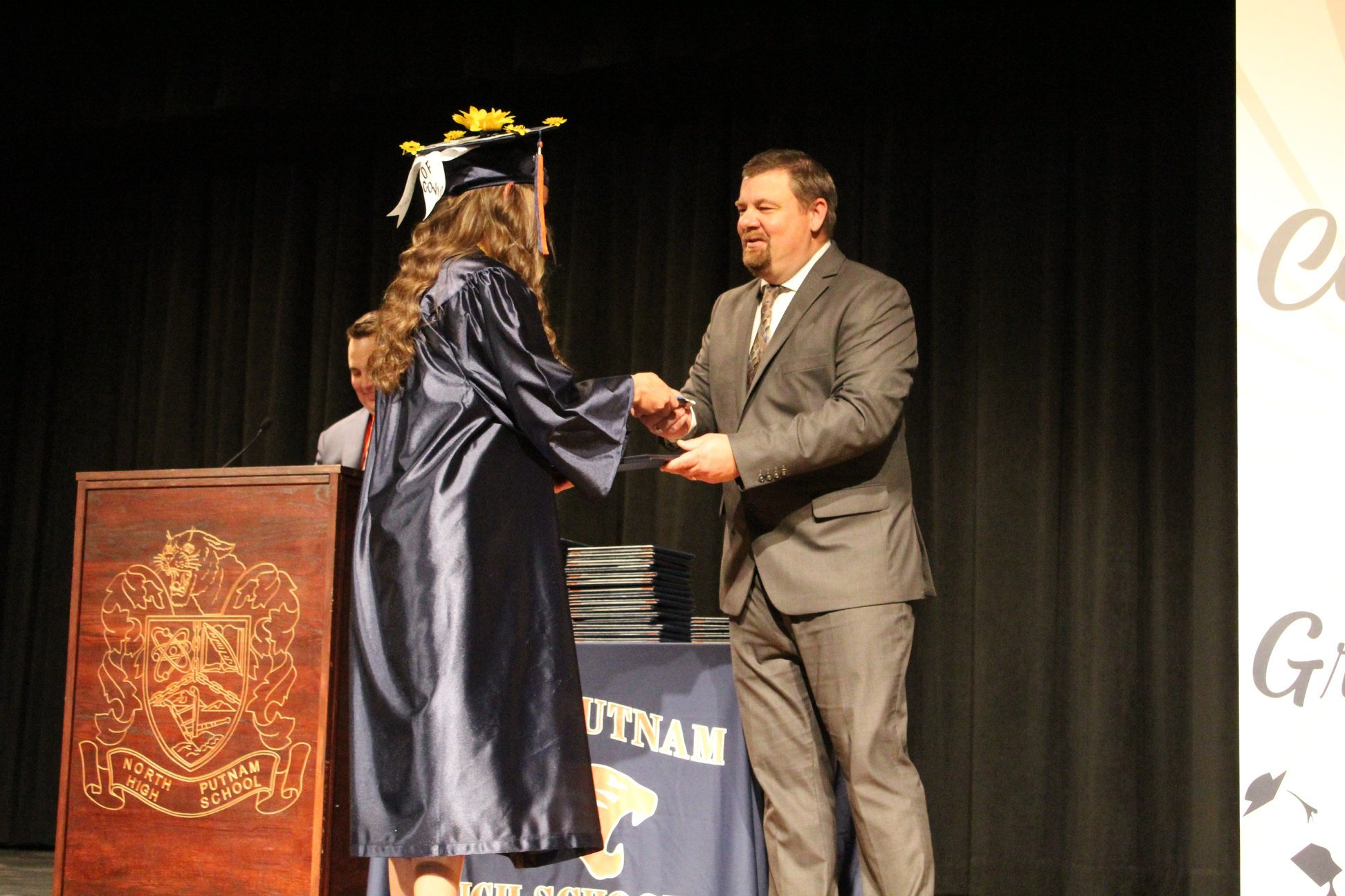 Student getting her diploma.